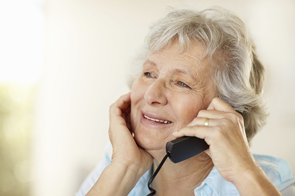 Lady using the telecare helpline